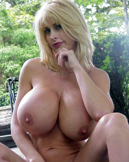Blonde babe with incredibly big boobs,..