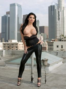 Busty model Aletta Ocean posing in..
